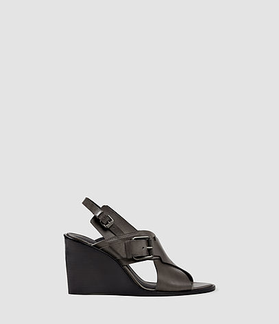 Elin Wedge Sandal - predominant colour: black; occasions: casual, holiday; material: leather; heel height: high; embellishment: buckles; heel: wedge; toe: open toe/peeptoe; style: strappy; finish: plain; pattern: plain; season: s/s 2016; wardrobe: highlight