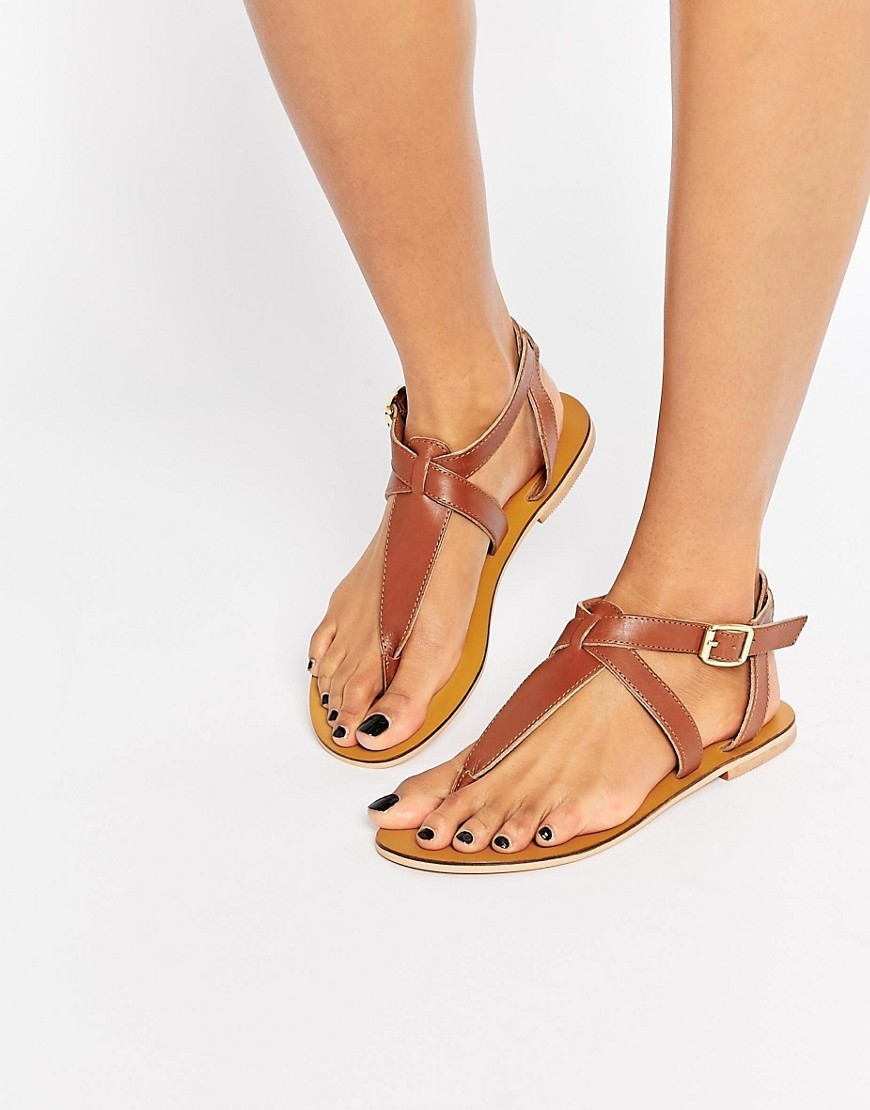 Toe Post Flat Sandals Tan - predominant colour: tan; occasions: casual, holiday; material: faux leather; heel height: flat; ankle detail: ankle strap; heel: standard; toe: toe thongs; style: strappy; finish: plain; pattern: plain; season: s/s 2016; wardrobe: highlight