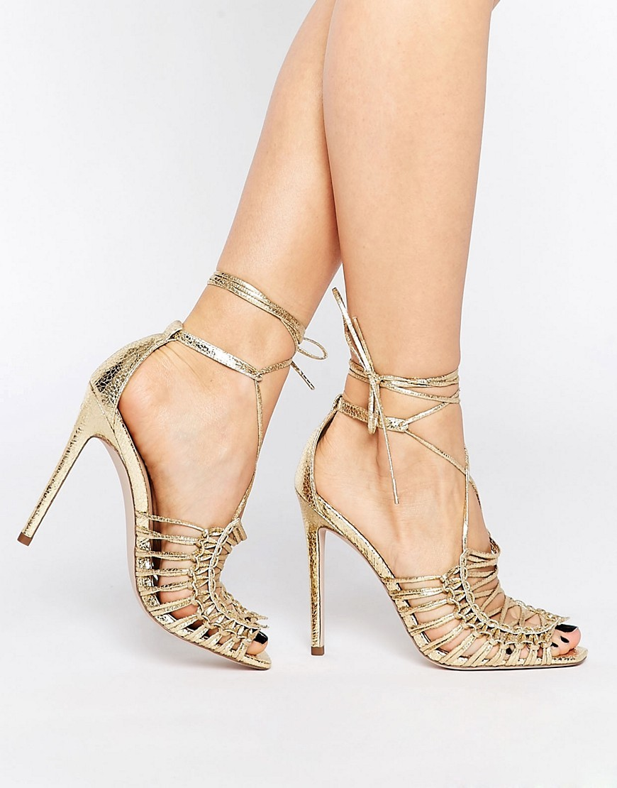 Hushed High Sandals Gold - predominant colour: gold; occasions: evening, occasion; material: faux leather; heel height: high; ankle detail: ankle tie; heel: stiletto; style: strappy; finish: metallic; pattern: plain; toe: caged; season: s/s 2016