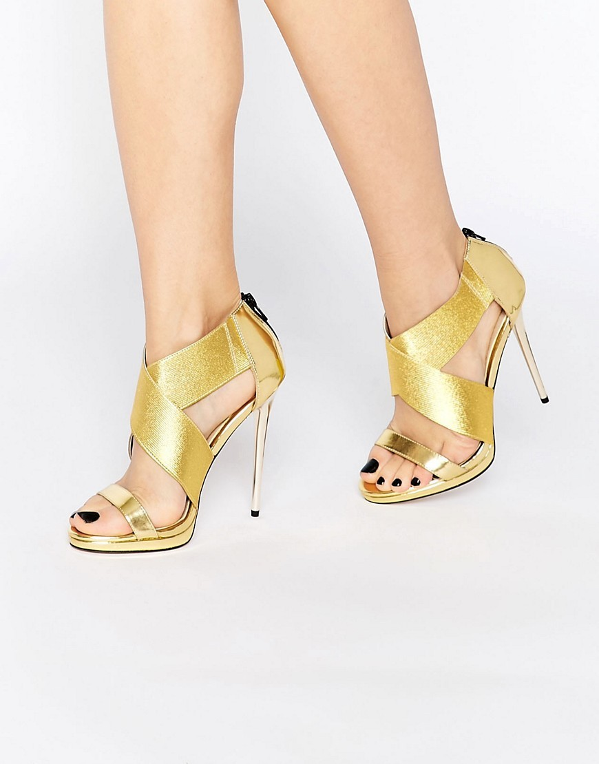 Hot To Trott Heeled Sandals Gold - predominant colour: gold; occasions: evening, occasion; material: faux leather; ankle detail: ankle strap; heel: stiletto; toe: open toe/peeptoe; style: strappy; finish: metallic; pattern: plain; heel height: very high; season: s/s 2016