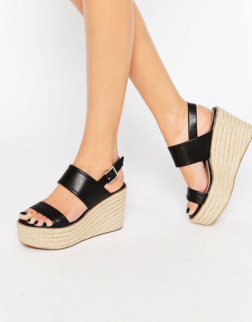 Scarantino Platform Espadrille Wedges Black Leather - predominant colour: black; occasions: casual, holiday; material: leather; heel height: mid; ankle detail: ankle strap; heel: wedge; toe: open toe/peeptoe; style: strappy; finish: plain; pattern: plain; shoe detail: platform; season: s/s 2016