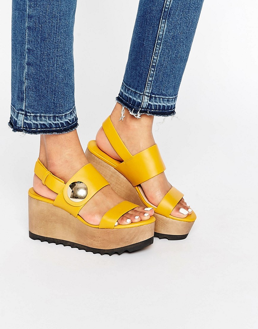 Wooden Flatform Sandal Yellow - predominant colour: yellow; occasions: casual, holiday, creative work; material: faux leather; heel height: mid; ankle detail: ankle strap; heel: wedge; toe: open toe/peeptoe; style: strappy; finish: plain; pattern: plain; shoe detail: platform; season: s/s 2016