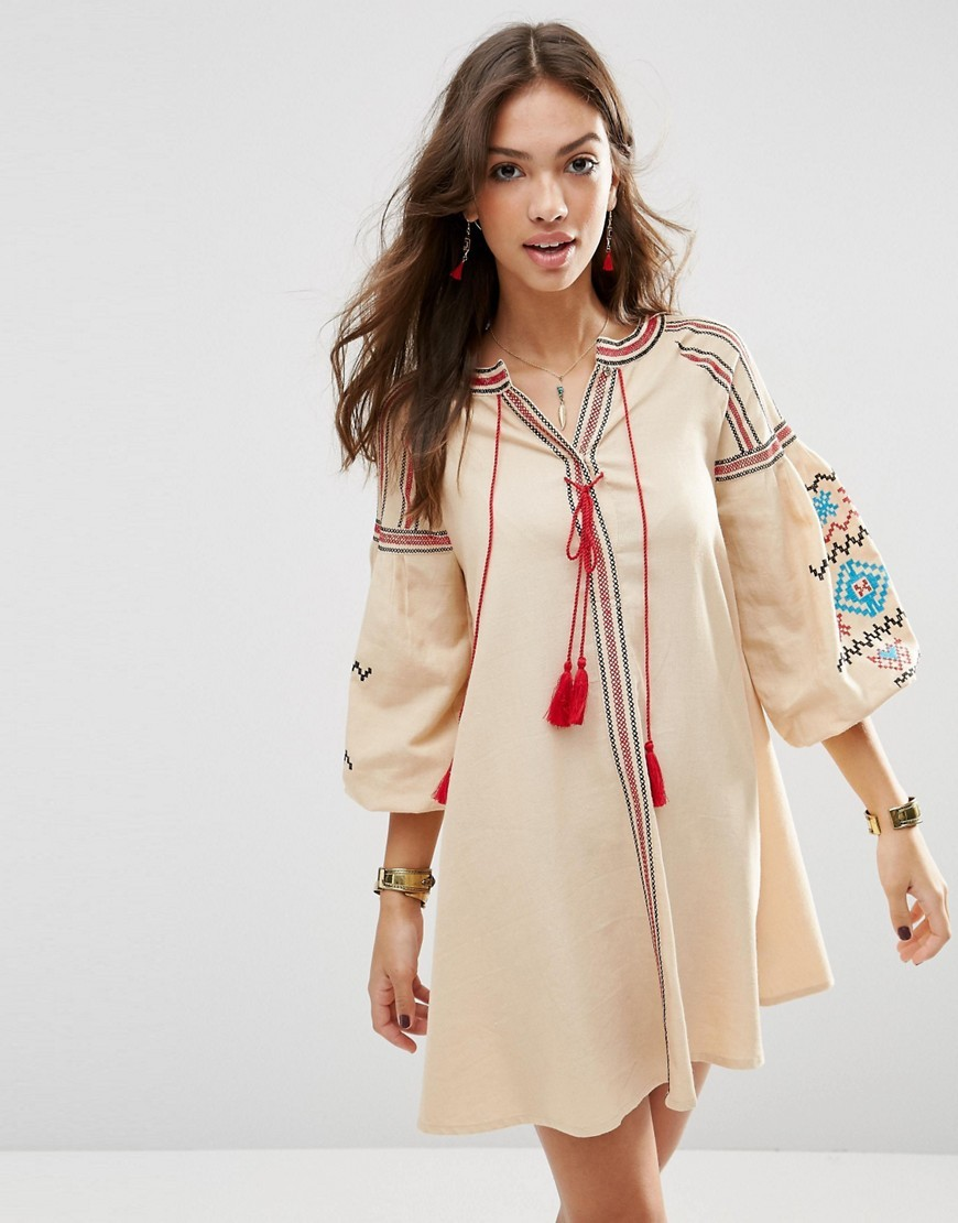 Premium Swing Dress With Aztec Embroidery Cream - style: smock; neckline: v-neck; fit: loose; predominant colour: ivory/cream; secondary colour: true red; occasions: casual; length: just above the knee; sleeve length: long sleeve; sleeve style: standard; texture group: cotton feel fabrics; pattern type: fabric; pattern: patterned/print; embellishment: embroidered; fibres: viscose/rayon - mix; multicoloured: multicoloured; season: s/s 2016; wardrobe: highlight