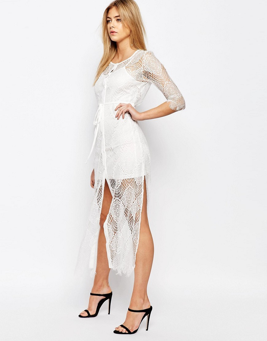Karley Lace Dress With Slip Ivory - style: shift; length: mini; neckline: round neck; predominant colour: white; fit: body skimming; fibres: polyester/polyamide - 100%; occasions: occasion; sleeve length: 3/4 length; sleeve style: standard; texture group: lace; pattern type: fabric; pattern size: standard; pattern: patterned/print; season: s/s 2016; wardrobe: event