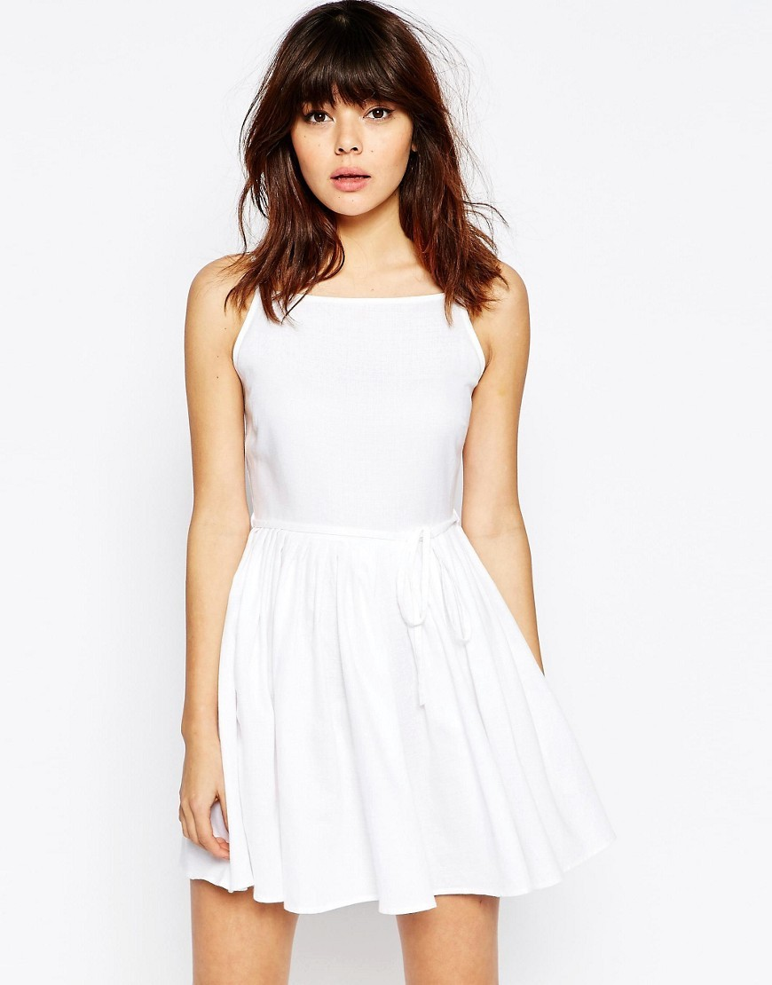 Mini Sundress With Full Skirt White - length: mid thigh; pattern: plain; sleeve style: sleeveless; predominant colour: white; occasions: casual; fit: fitted at waist & bust; style: fit & flare; fibres: viscose/rayon - stretch; neckline: crew; sleeve length: sleeveless; pattern type: fabric; texture group: jersey - stretchy/drapey; season: s/s 2016