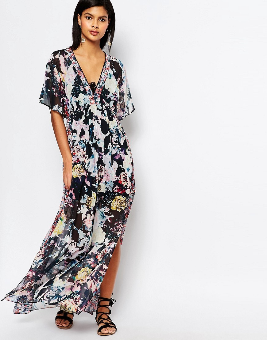 Evelyn Rose Print Maxi Dress Pink Salt - neckline: low v-neck; style: maxi dress; length: ankle length; predominant colour: blush; secondary colour: black; occasions: evening; fit: body skimming; fibres: polyester/polyamide - 100%; sleeve length: half sleeve; sleeve style: standard; pattern type: fabric; pattern: florals; texture group: other - light to midweight; multicoloured: multicoloured; season: s/s 2016; wardrobe: event