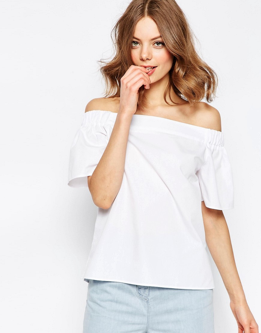 Off The Shoulder Top In Cotton White - neckline: off the shoulder; pattern: plain; style: t-shirt; predominant colour: white; occasions: casual, creative work; length: standard; fibres: cotton - 100%; fit: body skimming; sleeve length: short sleeve; sleeve style: standard; pattern type: fabric; texture group: jersey - stretchy/drapey; season: s/s 2016; wardrobe: highlight