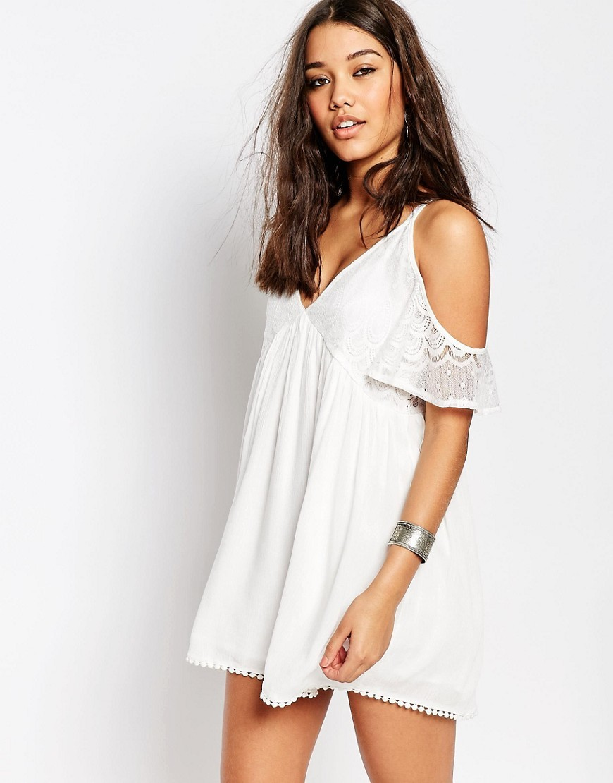 Cold Shoulder Lace Insert Swing Dress White - style: smock; length: mini; neckline: low v-neck; fit: loose; predominant colour: white; fibres: viscose/rayon - 100%; shoulder detail: cut out shoulder; sleeve length: short sleeve; sleeve style: standard; texture group: lace; occasions: holiday; pattern type: fabric; pattern: patterned/print; embellishment: lace; season: s/s 2016; wardrobe: holiday