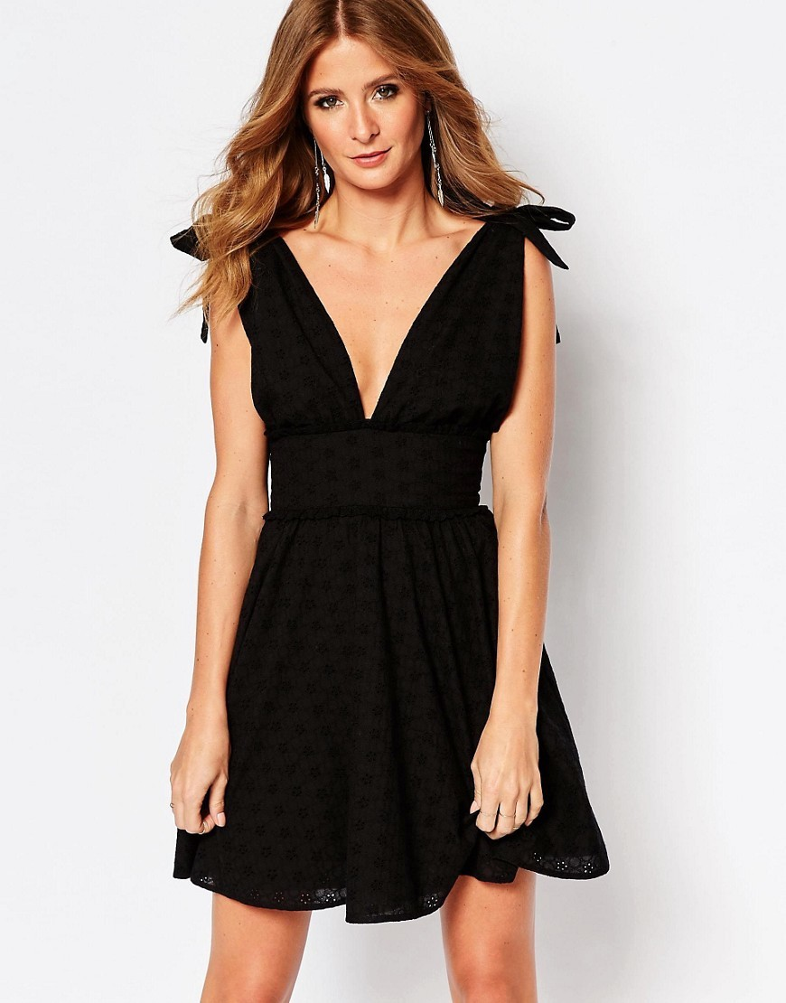 Bow Mini Dress In Broderie Anglaise Black - length: mid thigh; neckline: plunge; pattern: plain; sleeve style: sleeveless; predominant colour: black; occasions: evening; fit: fitted at waist & bust; style: fit & flare; fibres: cotton - 100%; sleeve length: sleeveless; pattern type: fabric; texture group: other - light to midweight; season: s/s 2016; wardrobe: event