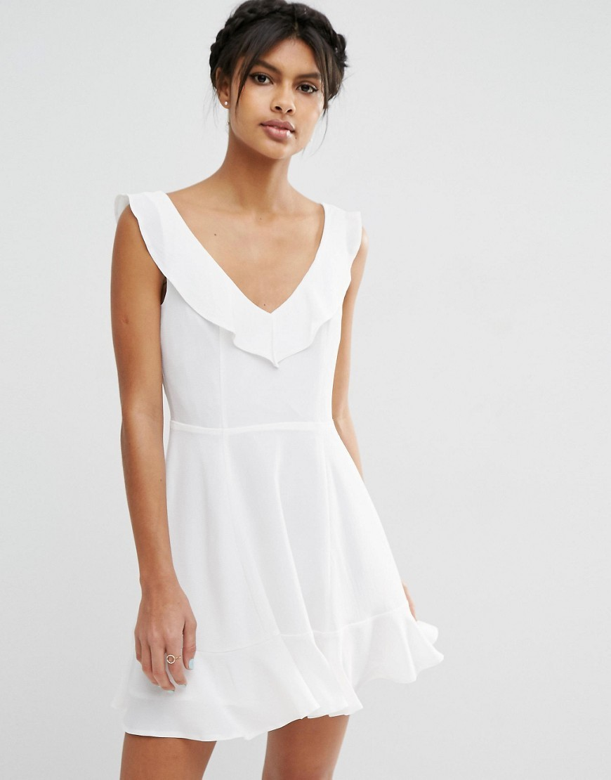 Skater Dress With Frill Detail Ivory - length: mid thigh; neckline: low v-neck; pattern: plain; sleeve style: sleeveless; predominant colour: ivory/cream; occasions: casual, holiday; fit: fitted at waist & bust; style: fit & flare; fibres: polyester/polyamide - stretch; sleeve length: sleeveless; pattern type: fabric; texture group: other - light to midweight; season: s/s 2016; wardrobe: basic