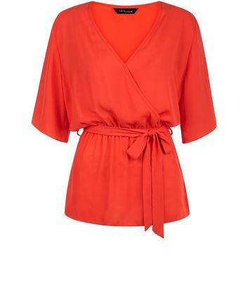 Bright Orange Belted Wrap 1/2 Sleeve Top - neckline: low v-neck; sleeve style: dolman/batwing; pattern: plain; style: wrap/faux wrap; waist detail: belted waist/tie at waist/drawstring; predominant colour: bright orange; occasions: casual, creative work; length: standard; fibres: polyester/polyamide - 100%; fit: body skimming; sleeve length: half sleeve; texture group: crepes; pattern type: fabric; season: s/s 2016; wardrobe: highlight