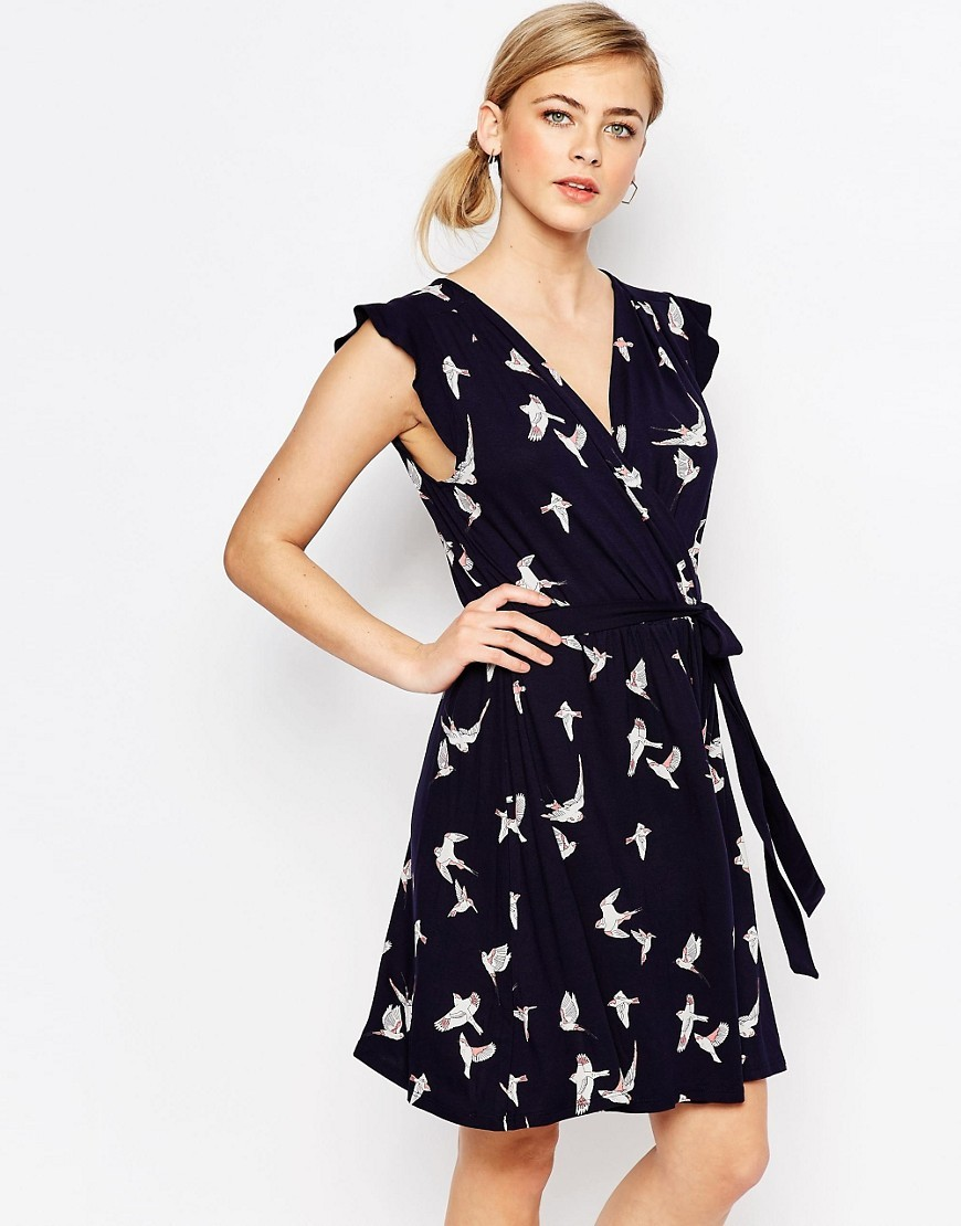 Bird Print Jersey Dress Navy - style: faux wrap/wrap; neckline: low v-neck; fit: fitted at waist; sleeve style: sleeveless; waist detail: belted waist/tie at waist/drawstring; secondary colour: white; predominant colour: navy; occasions: evening, creative work; length: just above the knee; fibres: viscose/rayon - stretch; sleeve length: sleeveless; pattern type: fabric; pattern: patterned/print; texture group: jersey - stretchy/drapey; season: s/s 2016