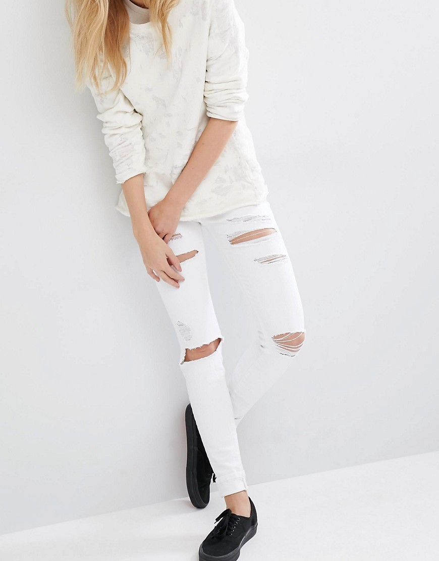 Regina Mid Rise Skinny Destroyed Jeans White - style: skinny leg; pattern: plain; pocket detail: traditional 5 pocket; waist: mid/regular rise; predominant colour: white; occasions: casual; length: ankle length; fibres: cotton - stretch; texture group: denim; pattern type: fabric; season: s/s 2016; wardrobe: highlight
