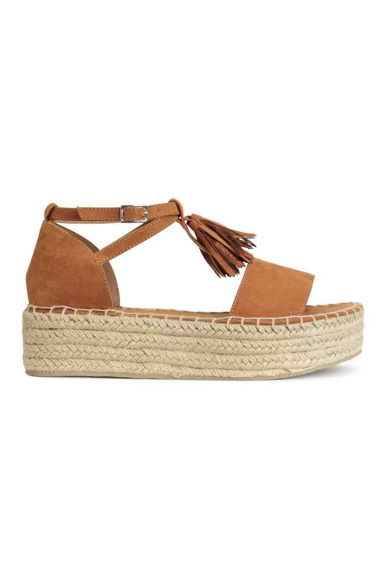 Platform Sandals - predominant colour: camel; occasions: casual, holiday; material: faux leather; heel height: flat; embellishment: tassels; ankle detail: ankle strap; heel: wedge; toe: open toe/peeptoe; style: strappy; finish: plain; pattern: plain; shoe detail: platform; season: s/s 2016; wardrobe: highlight