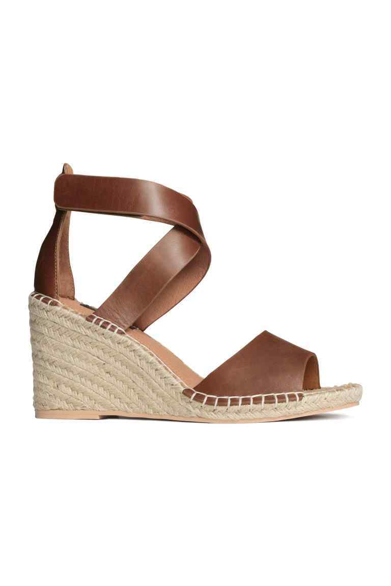 Leather Sandals - predominant colour: tan; occasions: casual, holiday; material: faux leather; heel height: high; ankle detail: ankle strap; heel: wedge; toe: open toe/peeptoe; style: strappy; finish: plain; pattern: plain; shoe detail: platform; season: s/s 2016