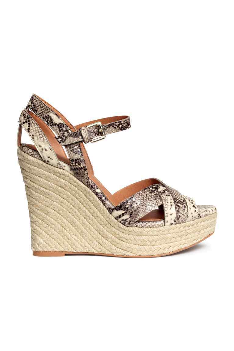 Wedge Heel Sandals - predominant colour: stone; secondary colour: charcoal; occasions: casual, holiday; material: faux leather; ankle detail: ankle strap; heel: wedge; toe: open toe/peeptoe; style: strappy; finish: plain; pattern: animal print; heel height: very high; shoe detail: platform; season: s/s 2016; wardrobe: highlight