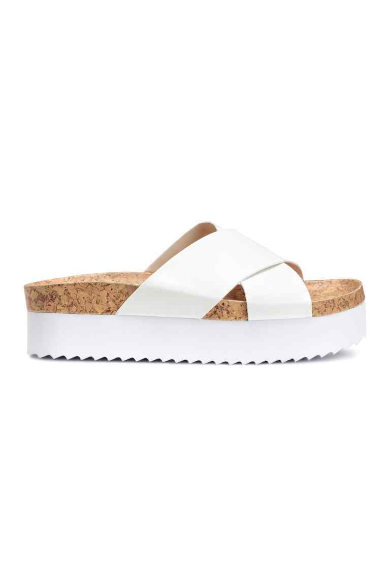 Platform Sandals - predominant colour: white; occasions: casual, holiday; material: faux leather; heel height: mid; heel: wedge; toe: open toe/peeptoe; style: slides; finish: plain; pattern: plain; shoe detail: platform; season: s/s 2016; wardrobe: highlight