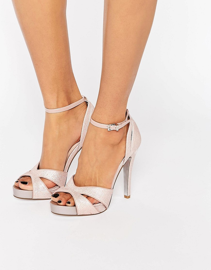 Lindsay Pink Glittery Cut Out Heeled Sandals Pink - predominant colour: blush; occasions: evening, occasion; material: faux leather; heel height: high; embellishment: glitter; ankle detail: ankle strap; heel: stiletto; toe: open toe/peeptoe; style: strappy; finish: metallic; pattern: plain; shoe detail: platform; season: s/s 2016; wardrobe: event