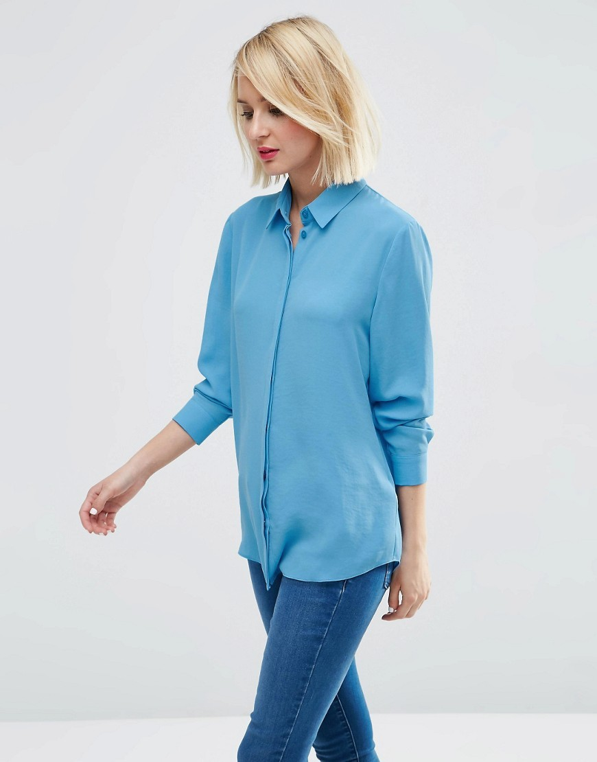 Blouse Corn Flower Blue - neckline: shirt collar/peter pan/zip with opening; pattern: plain; length: below the bottom; style: shirt; predominant colour: diva blue; occasions: casual, work, creative work; fibres: polyester/polyamide - 100%; fit: body skimming; sleeve length: long sleeve; sleeve style: standard; texture group: sheer fabrics/chiffon/organza etc.; pattern type: fabric; season: s/s 2016; wardrobe: highlight