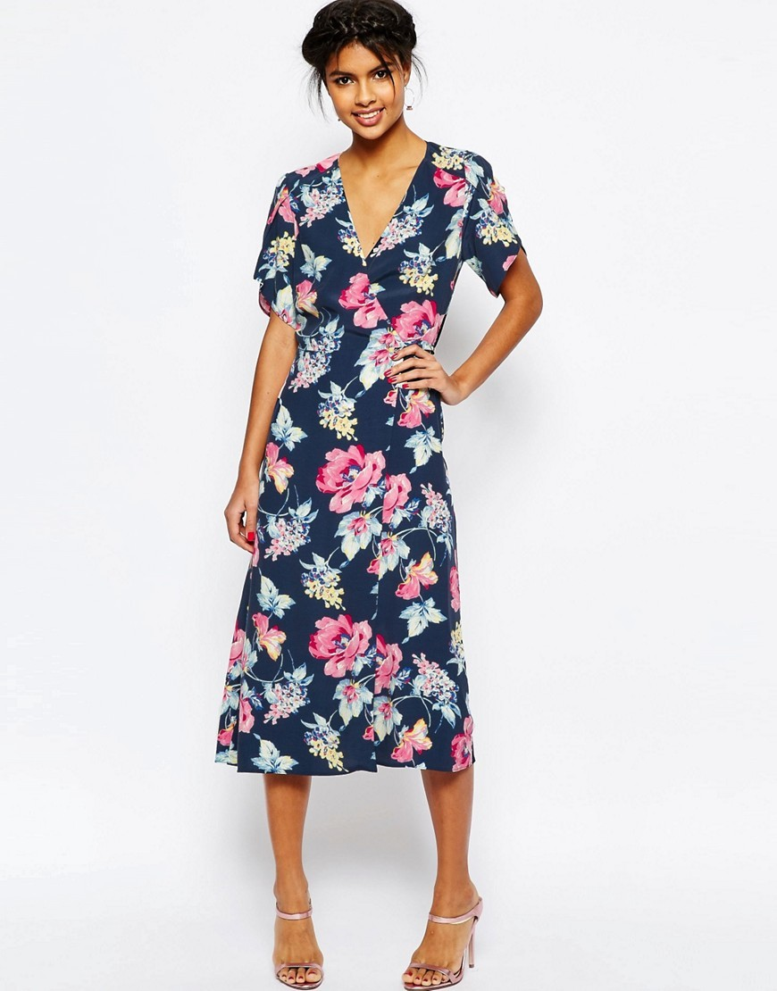 Floral Midi Tea Dress Navy Print - style: faux wrap/wrap; length: below the knee; neckline: low v-neck; secondary colour: pink; predominant colour: navy; fit: soft a-line; fibres: polyester/polyamide - 100%; occasions: occasion; sleeve length: short sleeve; sleeve style: standard; pattern type: fabric; pattern size: standard; pattern: florals; texture group: woven light midweight; season: s/s 2016; wardrobe: event