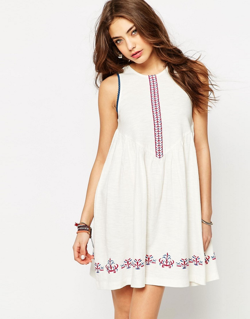 Embroidered Smock Sundress Ivory - length: mid thigh; fit: loose; sleeve style: sleeveless; style: sundress; predominant colour: white; secondary colour: hot pink; fibres: cotton - 100%; neckline: crew; sleeve length: sleeveless; texture group: cotton feel fabrics; occasions: holiday; pattern type: fabric; pattern size: light/subtle; pattern: patterned/print; embellishment: embroidered; season: s/s 2016