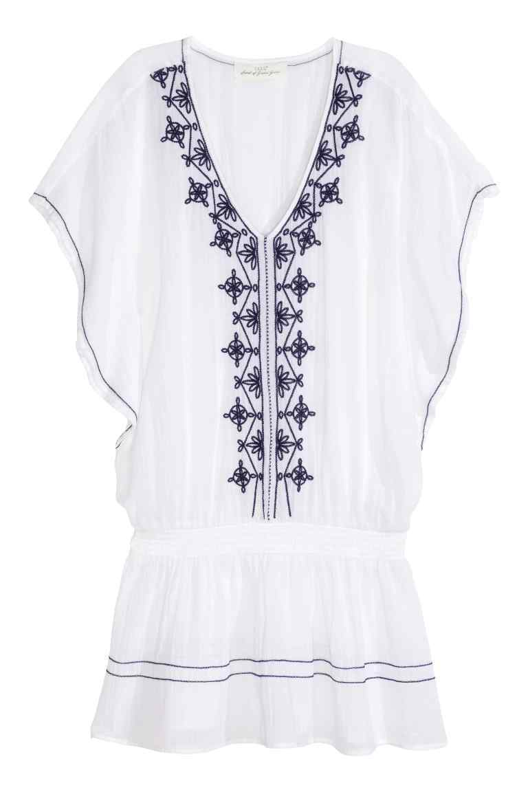Embroidered Tunic - length: mini; neckline: low v-neck; sleeve style: dolman/batwing; fit: fitted at waist; style: blouson; predominant colour: white; secondary colour: navy; fibres: polyester/polyamide - mix; sleeve length: short sleeve; texture group: cotton feel fabrics; occasions: holiday; pattern type: fabric; pattern size: light/subtle; pattern: patterned/print; embellishment: embroidered; season: s/s 2016; wardrobe: holiday; embellishment location: bust, neck