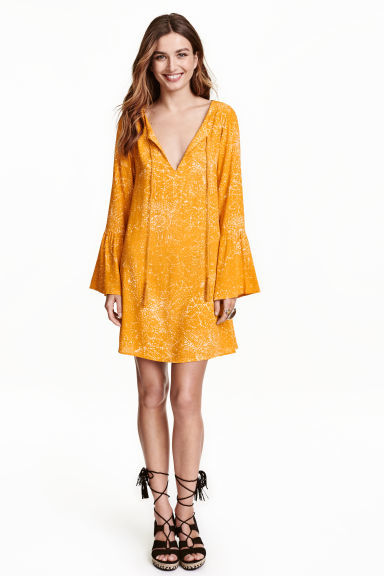 Patterned Dress - length: mid thigh; neckline: low v-neck; pattern: plain; style: kaftan; predominant colour: mustard; fit: soft a-line; fibres: polyester/polyamide - stretch; sleeve length: long sleeve; sleeve style: standard; texture group: cotton feel fabrics; occasions: holiday; pattern type: fabric; season: s/s 2016; wardrobe: holiday