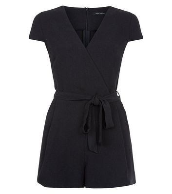 Black Wrap Front Tie Waist Playsuit - neckline: round neck; sleeve style: capped; fit: tailored/fitted; pattern: plain; waist detail: belted waist/tie at waist/drawstring; length: mid thigh shorts; predominant colour: black; occasions: casual, holiday; fibres: polyester/polyamide - 100%; sleeve length: short sleeve; style: playsuit; pattern type: fabric; texture group: jersey - stretchy/drapey; season: s/s 2016; wardrobe: holiday