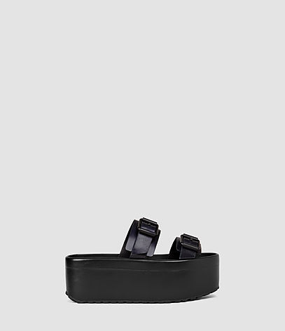 Knox Sandal - predominant colour: black; occasions: casual, holiday; material: leather; heel height: mid; embellishment: buckles; heel: wedge; toe: open toe/peeptoe; style: slides; finish: plain; pattern: plain; shoe detail: platform; season: s/s 2016; wardrobe: highlight