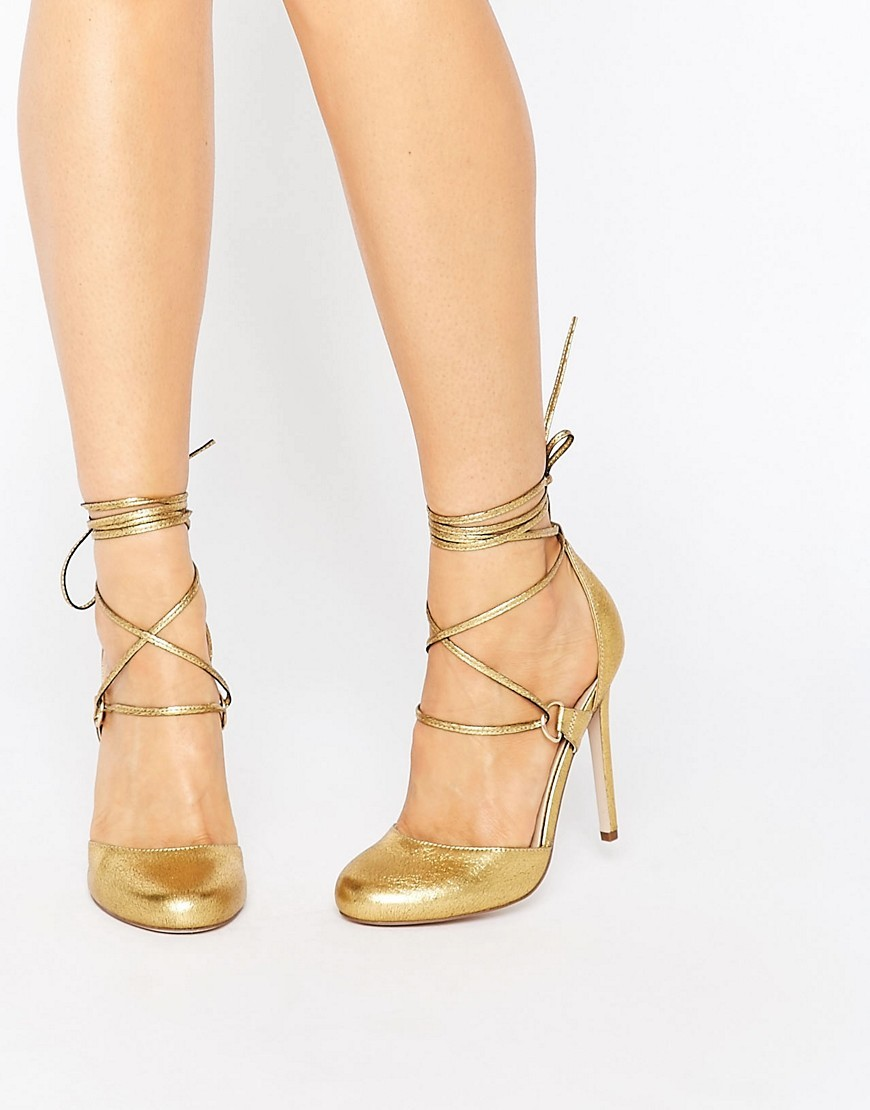 Persevere Lace Up High Heels Gold - predominant colour: gold; occasions: evening, occasion; material: faux leather; heel height: high; ankle detail: ankle tie; heel: stiletto; toe: round toe; style: courts; finish: metallic; pattern: plain; season: s/s 2016; wardrobe: event
