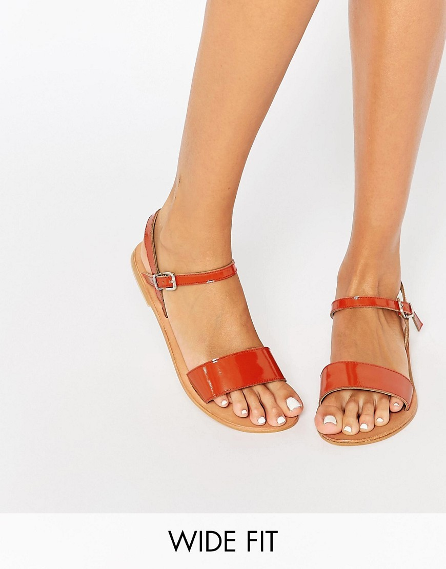 Flight Wide Fit Leather Sandals Coral - predominant colour: coral; occasions: casual, holiday; material: leather; heel height: flat; ankle detail: ankle strap; heel: standard; toe: open toe/peeptoe; style: standard; finish: patent; pattern: plain; season: s/s 2016