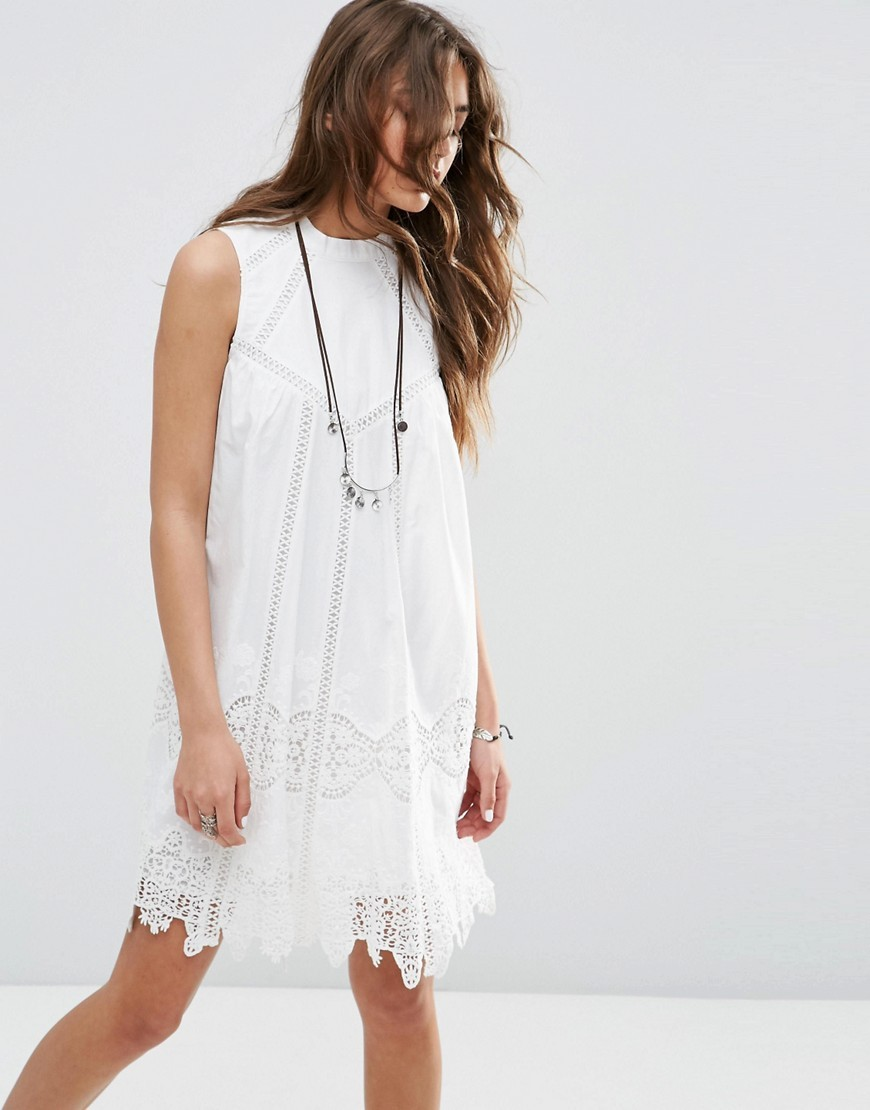 Premium Ladder And Lace Swing Sundress With High Neck White - style: tunic; sleeve style: sleeveless; predominant colour: white; length: just above the knee; fit: soft a-line; fibres: cotton - 100%; occasions: occasion, holiday; neckline: crew; sleeve length: sleeveless; texture group: cotton feel fabrics; pattern type: fabric; pattern: patterned/print; embellishment: lace; season: s/s 2016; wardrobe: highlight