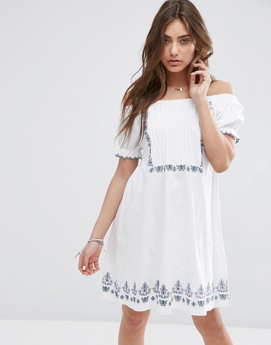 Off Shoulder Sundress With Border Embroidery White - style: tunic; neckline: off the shoulder; predominant colour: white; secondary colour: navy; occasions: casual; length: just above the knee; fit: soft a-line; fibres: cotton - 100%; sleeve length: short sleeve; sleeve style: standard; pattern type: fabric; pattern size: standard; pattern: patterned/print; texture group: jersey - stretchy/drapey; embellishment: embroidered; season: s/s 2016; wardrobe: highlight