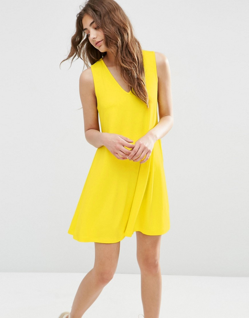 Sleeveless V Neck Swing Dress Yellow - style: shift; neckline: low v-neck; pattern: plain; sleeve style: sleeveless; predominant colour: yellow; occasions: casual; length: just above the knee; fit: soft a-line; fibres: viscose/rayon - stretch; sleeve length: sleeveless; pattern type: fabric; texture group: jersey - stretchy/drapey; season: s/s 2016; wardrobe: highlight