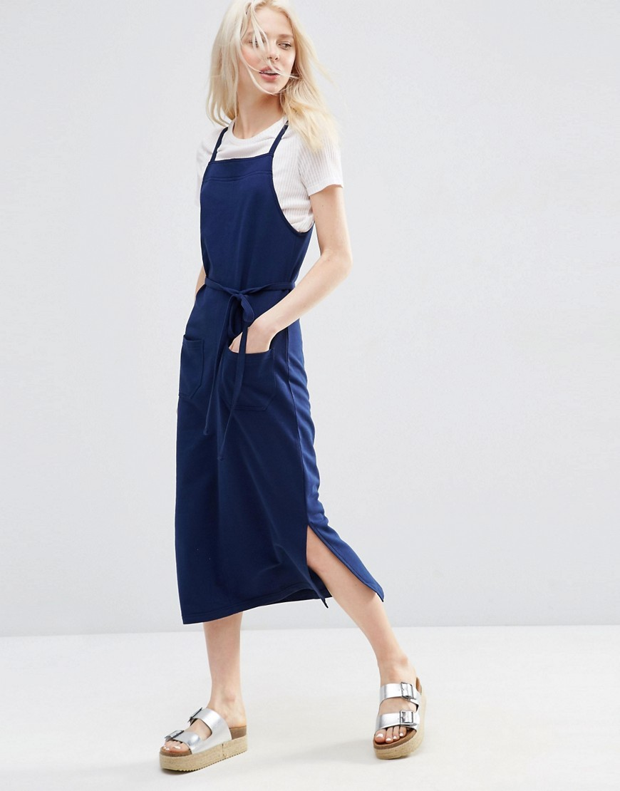 Pinafore Midi Dress In Indigo Indigo - length: below the knee; pattern: plain; sleeve style: sleeveless; style: dungaree dress/pinafore; waist detail: belted waist/tie at waist/drawstring; predominant colour: navy; occasions: casual; fit: body skimming; fibres: cotton - 100%; sleeve length: sleeveless; neckline: medium square neck; pattern type: fabric; texture group: other - light to midweight; season: s/s 2016