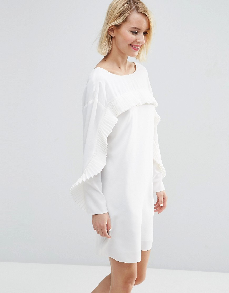 Shift Dress With Pleat Ruffle Detail Ivory - style: shift; neckline: round neck; pattern: plain; predominant colour: ivory/cream; length: just above the knee; fit: body skimming; fibres: polyester/polyamide - 100%; shoulder detail: bulky shoulder detail; sleeve length: long sleeve; sleeve style: standard; bust detail: bulky details at bust; pattern type: fabric; texture group: other - light to midweight; occasions: creative work; season: s/s 2016; wardrobe: highlight