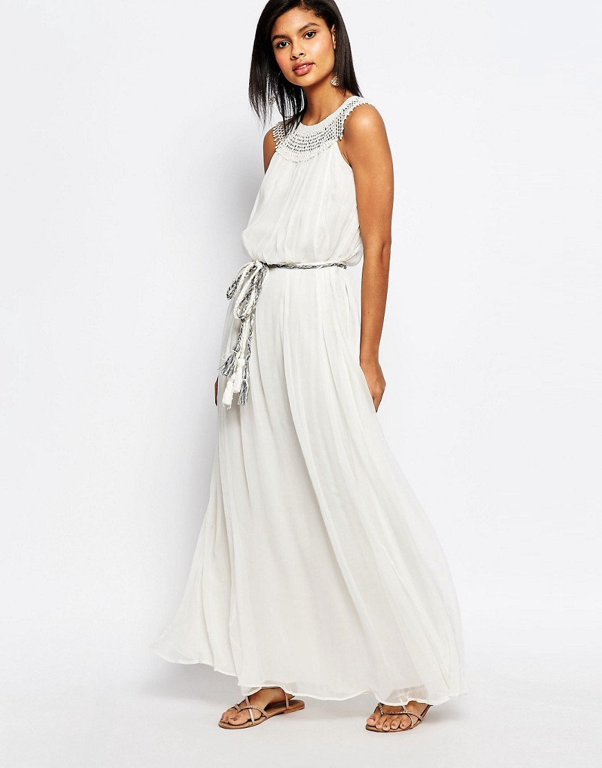 Amboseli Beaded Maxi Dress Daisy White - neckline: round neck; fit: fitted at waist; pattern: plain; sleeve style: sleeveless; style: maxi dress; length: ankle length; waist detail: belted waist/tie at waist/drawstring; predominant colour: white; fibres: polyester/polyamide - 100%; hip detail: subtle/flattering hip detail; sleeve length: sleeveless; texture group: sheer fabrics/chiffon/organza etc.; occasions: holiday; pattern type: fabric; embellishment: beading; season: s/s 2016; wardrobe: holiday; embellishment location: shoulder