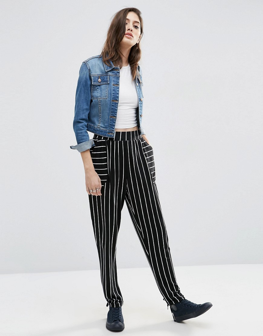 Jersey Peg Trousers In Mono Stripe Mono - length: standard; pattern: vertical stripes; style: peg leg; waist: high rise; secondary colour: white; predominant colour: black; occasions: casual; fibres: cotton - stretch; waist detail: feature waist detail; trends: monochrome; fit: tapered; pattern type: fabric; texture group: jersey - stretchy/drapey; pattern size: standard (bottom); season: s/s 2016; wardrobe: highlight
