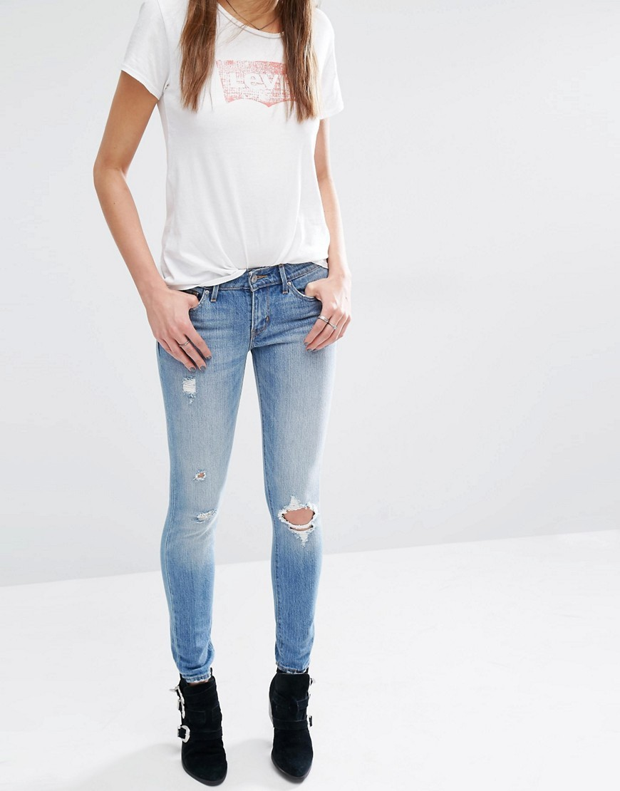 711 Mid Rise Skinny Jeans Goodbye Heart Blue - style: skinny leg; length: standard; pattern: plain; pocket detail: traditional 5 pocket; waist: mid/regular rise; predominant colour: pale blue; occasions: casual; fibres: cotton - stretch; jeans detail: shading down centre of thigh, rips; texture group: denim; pattern type: fabric; season: s/s 2016; wardrobe: basic