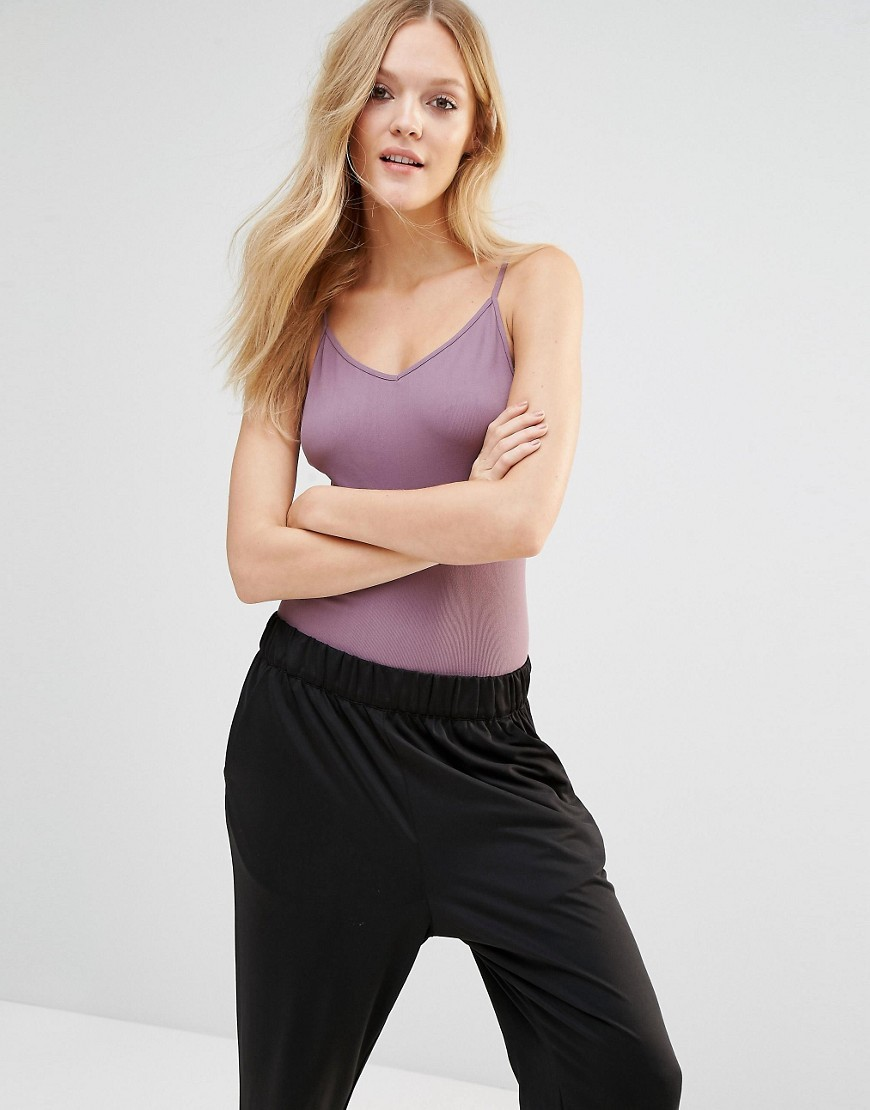 Movement Bodysuit Rose - neckline: low v-neck; sleeve style: spaghetti straps; pattern: plain; predominant colour: lilac; occasions: casual, creative work; length: standard; fibres: nylon - mix; fit: tight; sleeve length: sleeveless; texture group: jersey - clingy; pattern type: fabric; style: bodysuit; season: s/s 2016; wardrobe: highlight