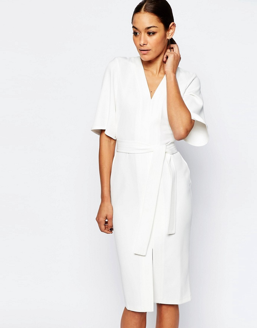 Clean Obi Wrap Dress With V Front Ivory - style: faux wrap/wrap; length: below the knee; neckline: v-neck; sleeve style: dolman/batwing; fit: tailored/fitted; pattern: plain; waist detail: belted waist/tie at waist/drawstring; predominant colour: ivory/cream; fibres: polyester/polyamide - 100%; occasions: occasion, creative work; sleeve length: half sleeve; texture group: crepes; pattern type: fabric; season: s/s 2016; wardrobe: investment