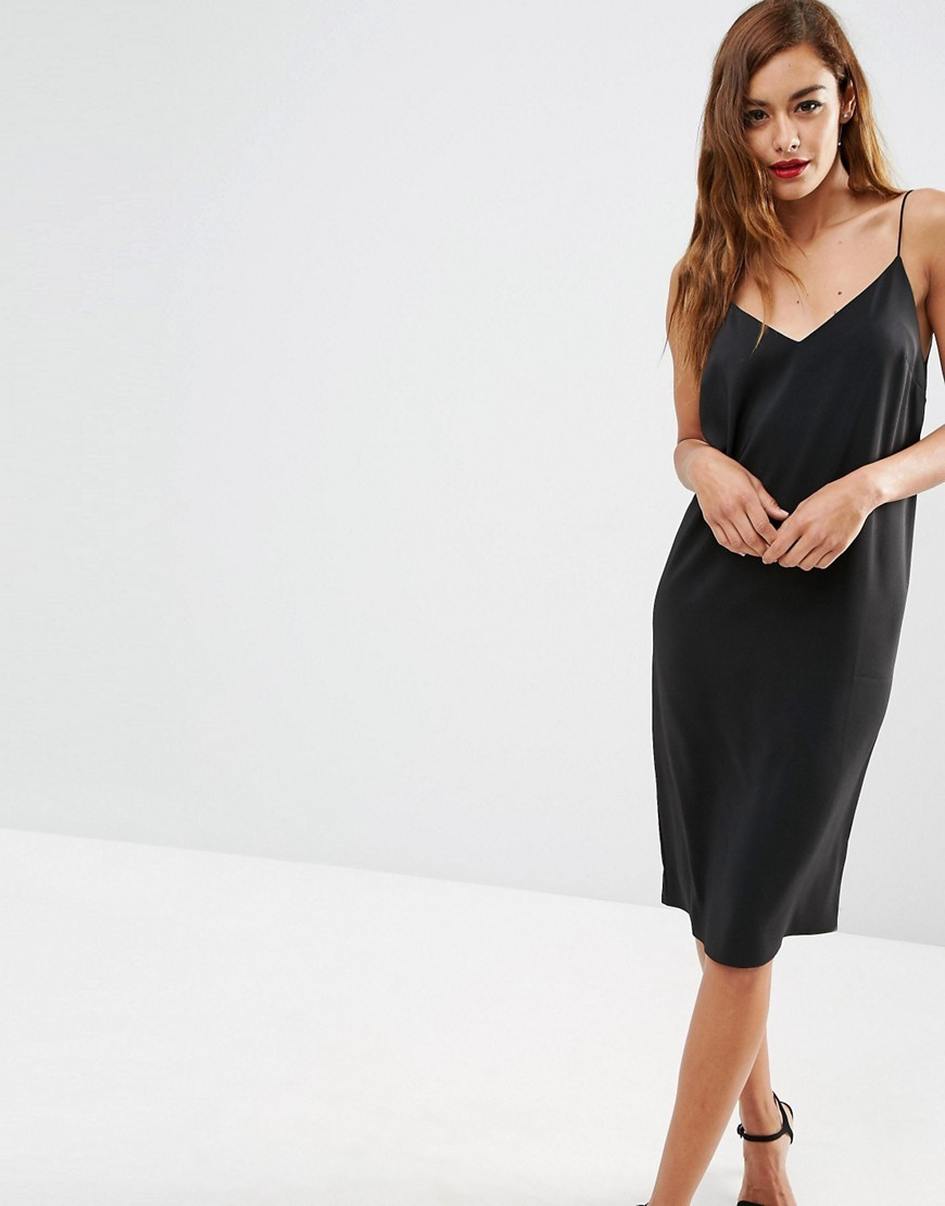 Midi Slip Dress Black - length: below the knee; neckline: low v-neck; sleeve style: spaghetti straps; pattern: plain; predominant colour: black; occasions: evening; fit: body skimming; style: slip dress; fibres: polyester/polyamide - stretch; sleeve length: sleeveless; pattern type: fabric; texture group: other - light to midweight; season: s/s 2016; wardrobe: event
