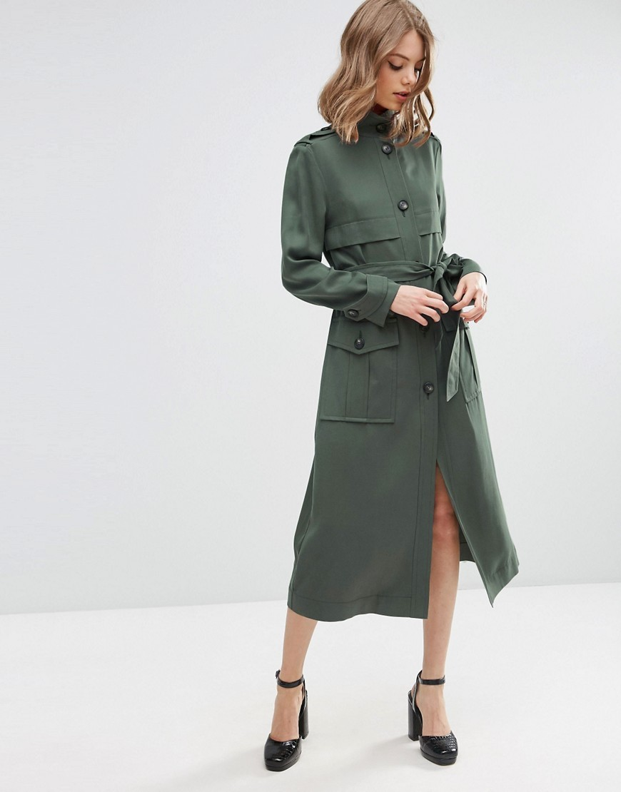 Duster Coat In Utility Styling Khaki - pattern: plain; style: trench coat; length: calf length; predominant colour: khaki; occasions: casual, creative work; fit: straight cut (boxy); fibres: polyester/polyamide - 100%; collar: shirt collar/peter pan/zip with opening; waist detail: belted waist/tie at waist/drawstring; sleeve length: long sleeve; sleeve style: standard; texture group: crepes; collar break: high/illusion of break when open; pattern type: fabric; season: s/s 2016; wardrobe: basic