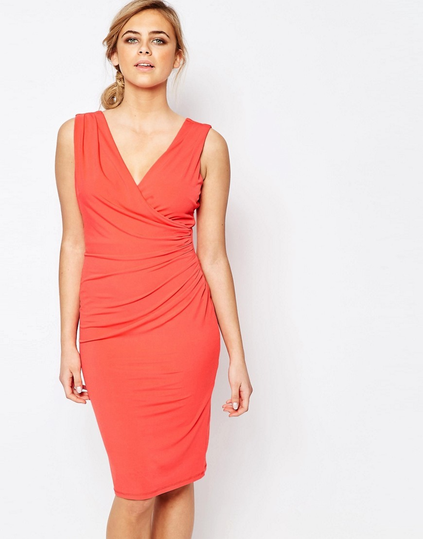 Ruched V Neck Dress Coral - style: faux wrap/wrap; neckline: low v-neck; sleeve style: standard vest straps/shoulder straps; hip detail: fitted at hip; bust detail: ruching/gathering/draping/layers/pintuck pleats at bust; predominant colour: coral; occasions: evening, occasion; length: on the knee; fit: body skimming; fibres: polyester/polyamide - stretch; sleeve length: sleeveless; texture group: jersey - clingy; pattern type: fabric; pattern: patterned/print; season: s/s 2016; wardrobe: event