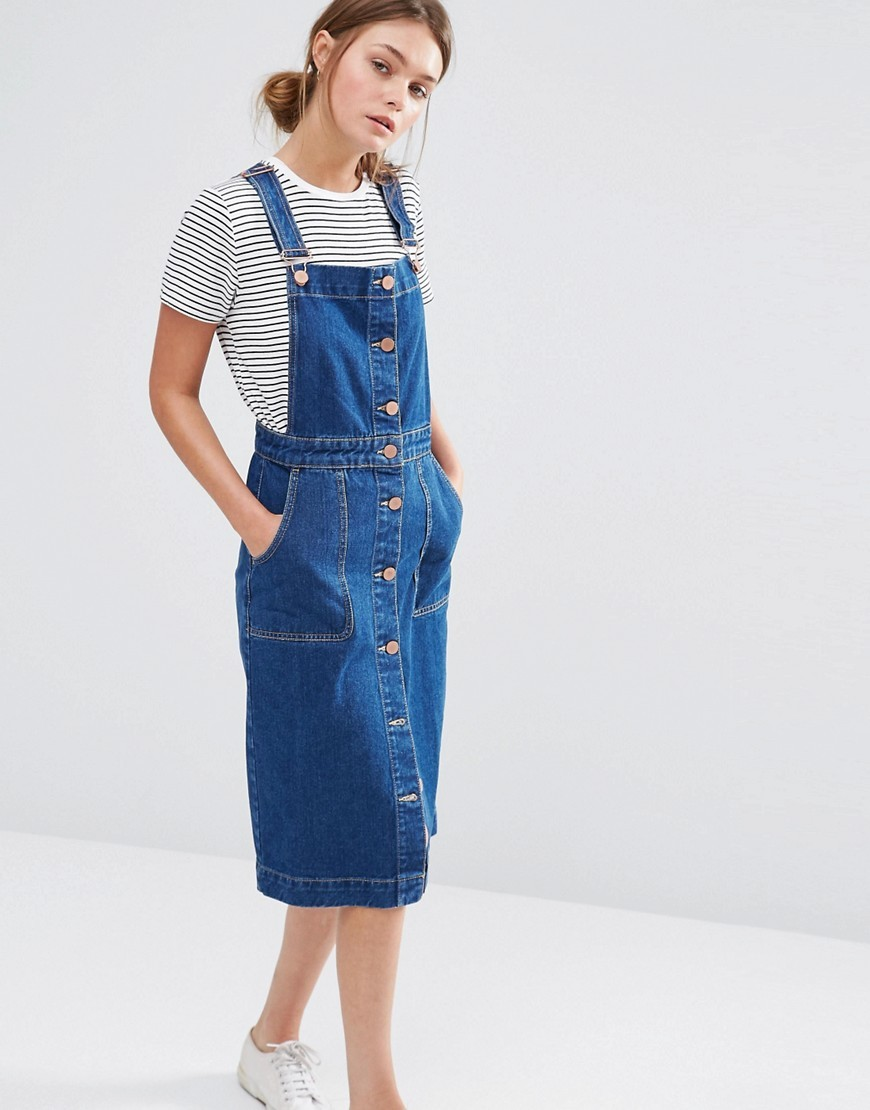 Denim Button Through Dungaree Dress Denim - length: below the knee; sleeve style: standard vest straps/shoulder straps; fit: tailored/fitted; pattern: plain; style: dungaree dress/pinafore; predominant colour: denim; occasions: casual; fibres: cotton - stretch; sleeve length: sleeveless; texture group: denim; neckline: low square neck; pattern type: fabric; season: s/s 2016; wardrobe: highlight