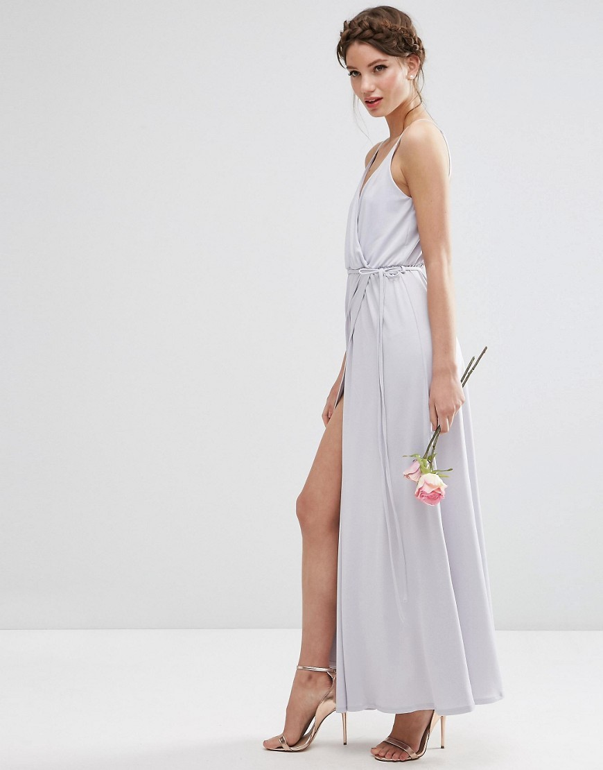 Wedding Crepe Strappy Wrap Maxi Dress Grey - style: faux wrap/wrap; neckline: low v-neck; fit: empire; pattern: plain; sleeve style: sleeveless; length: ankle length; bust detail: ruching/gathering/draping/layers/pintuck pleats at bust; predominant colour: mid grey; fibres: viscose/rayon - stretch; occasions: occasion; sleeve length: sleeveless; pattern type: fabric; texture group: other - light to midweight; season: s/s 2016