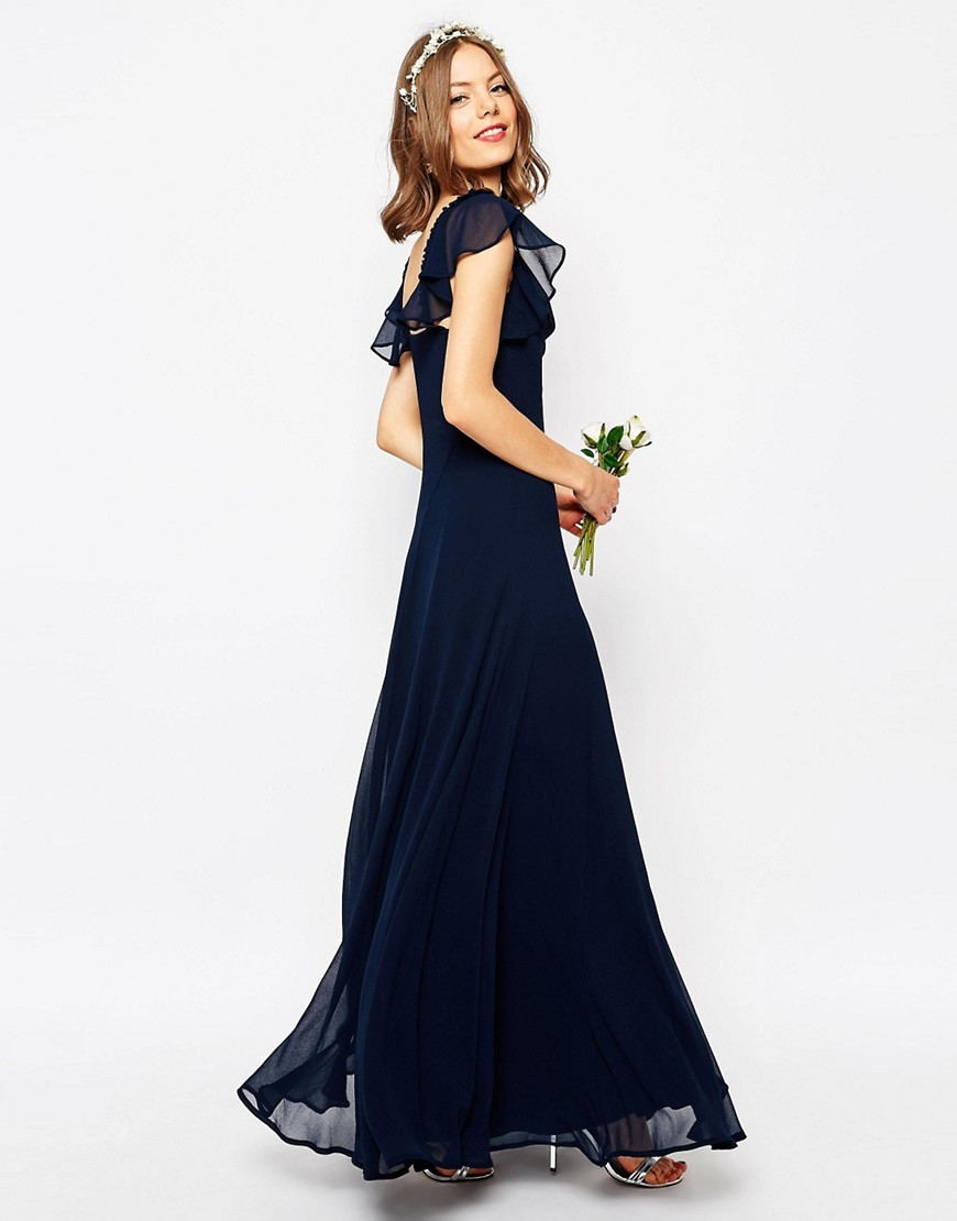 Wedding Frill Shoulder Detail Maxi Dress Navy - style: ballgown; neckline: cowl/draped neck; pattern: plain; sleeve style: sleeveless; back detail: low cut/open back; hip detail: fitted at hip; predominant colour: navy; length: floor length; fit: soft a-line; fibres: polyester/polyamide - 100%; occasions: occasion; sleeve length: sleeveless; texture group: sheer fabrics/chiffon/organza etc.; pattern type: fabric; shoulder detail: sheer at shoulder; season: s/s 2016; wardrobe: event
