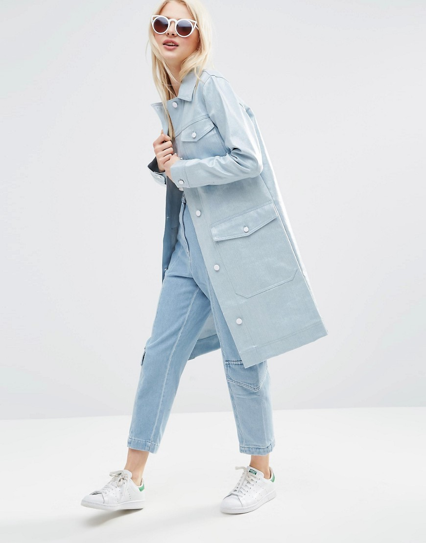 Premium Rain Mac In Coated Denim Light Blue - pattern: plain; style: mac; length: on the knee; predominant colour: pale blue; occasions: casual; fit: straight cut (boxy); fibres: cotton - mix; collar: shirt collar/peter pan/zip with opening; sleeve length: long sleeve; sleeve style: standard; texture group: denim; collar break: high; pattern type: fabric; season: s/s 2016; wardrobe: basic