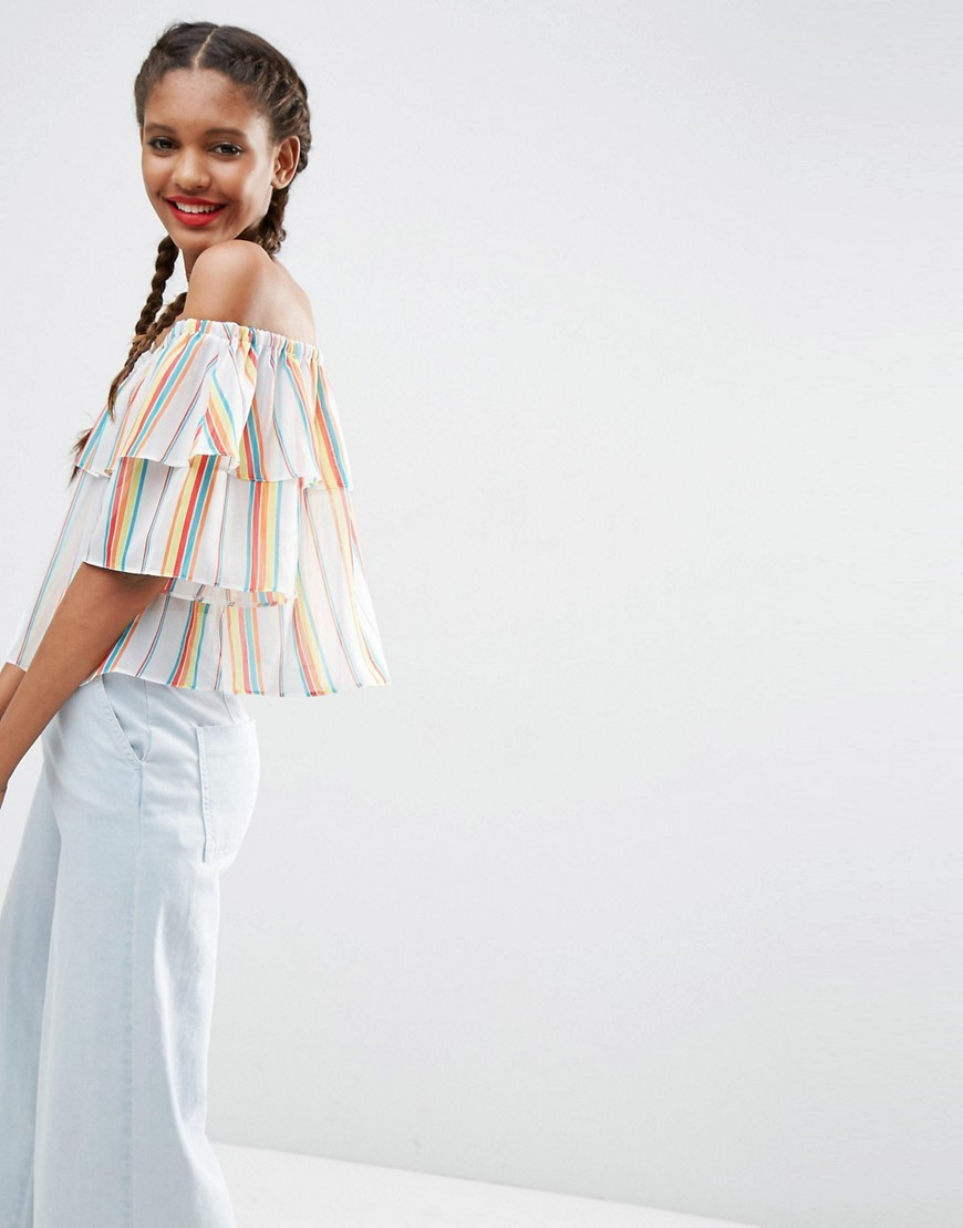 Ruffle Off The Shoulder In Rainbow Stripe Multi - neckline: off the shoulder; pattern: striped; predominant colour: ivory/cream; occasions: casual; length: standard; style: top; fibres: polyester/polyamide - 100%; fit: body skimming; sleeve length: short sleeve; sleeve style: standard; pattern type: fabric; pattern size: standard; texture group: other - light to midweight; multicoloured: multicoloured; season: s/s 2016; wardrobe: highlight