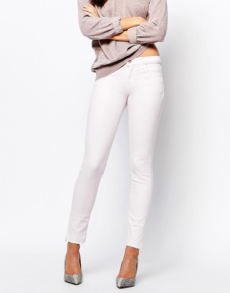 Mid Rise Skinny Jean With Raw Hem Pink - style: skinny leg; length: standard; pattern: plain; pocket detail: traditional 5 pocket; waist: mid/regular rise; predominant colour: blush; occasions: casual; fibres: cotton - stretch; texture group: denim; pattern type: fabric; season: s/s 2016; wardrobe: highlight